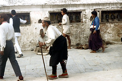 21-093 (ndpa / s. lundeen, archivist) Tags: nepal people woman man color men film hat cane 35mm beard 21 stupa buddhist nick oldman skirt fez prayerwheel barefoot kathmandu nepalese 1970s 1972 katmandu boudhanath himalayas nepali prayerwheels boudha dewolf whitebeard bouddhanath nickdewolf buddhiststupa boudhanathstupa photographbynickdewolf baudhanath bauddha khāsti reel21 jyarungkhasyor hillyregion