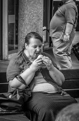 Satiation (Baz:Photog) Tags: leica stuffing lunch eating fat stomach sandwich belly hunger tummy hungry obesity obese fatlady eatinglunch biglady fatwoman bigstomach leicac twofatpeople eatingsitting