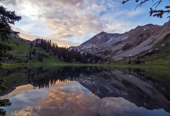 Geneva Lake Sunset Reflection (JakeBrewer) Tags: mountains reflections colorado rockymountains elk maroonbells genevalake elkmountains fourpassloop 4passloop