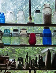 Window of antiques (sharon'soutlook) Tags: ohio window glass antiques belljar coloredglass masonjars metalobjects lookingoutawindow ftancienttradingpost
