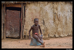 Himba: boy sitting outside his house (Dan Wiklund) Tags: africa boy portrait man male african hut namibia himba d800 2013