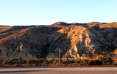 Stack train in the hills (hupspring) Tags: railroad sunlight mountain train hills southerncalifornia orangecounty freight bnsf shippingcontainers intermodal stacktrain bnsfsanbernardinosub