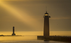 light beam - lighthouse (olsonj) Tags: morning summer orange lighthouse water fog dawn glow lakemichigan lightbeam