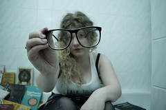Look! (omegon1701) Tags: glasses blue white tanktop longhair blonde books bathroom bathtube nerd geek girl woman cute perspective