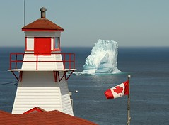 This is Canada (Karen_Chappell) Tags: ocean blue red lighthouse white seascape canada ice newfoundland flag atlantic iceberg nfld eastcoast atlanticcanada fortamherst avalonpeninsula