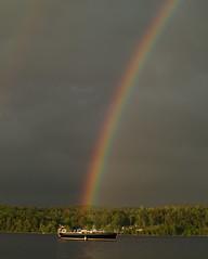 0008075 (Shakies Buddy) Tags: sky canada tree clouds sailboat river rainbow nb 200views saintjohnriver allrightsreserved nbphoto grandbaywestfield