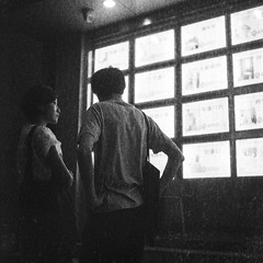 Couple in front of Real Estate listings, Beijing (Chemophilic) Tags: china 6x6 film rolleiflex beijing diafine ilford automat nikoncoolscan8000 dp3200 cs8000 tessar75cm35