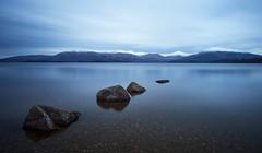 Rockin' It at Loch Lomond (barbaramartin1211) Tags: lochlomond water rocks scotland snow hills sky