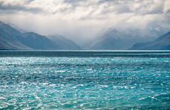 Lake Pukaki (zh3nya) Tags: newzealand blue lake alpine glacial clouds storm waves windy nz travel weater aqua torquoise shades shadow layers mountains southernalps nikon70200f4 d750
