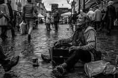 A wet workplace (AlphaAndi) Tags: monochrome menschen menschenbilder mono musician musiker music musik wow water wasser rain regen rainy trier tiefenschärfe deepoffield dof blackandwhite blackwhite bw sony streetshots schwarzweis street streetshooting streetportrait streets sw streetphotographie strase strasenleben streetlife