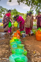 Lined up (HenryHutter) Tags: india water women village bottles poor jar cans canister supply inida makalidurga
