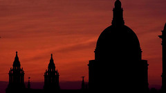 Fading St. Paul (Antony Zacharias) Tags: light sunset reflection london silhouette millenniumwheel thames towerbridge londonbridge river cityhall stpauls londoneye parliament bigben stpaulscathedral riverthames waterreflection londonbus redbus londonsunset hdrsky riverreflection