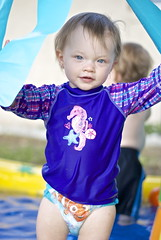 Water baby. (scenestreetphotography) Tags: old blue summer baby brown hot water pool swimming hair 50mm one eyes nikon toddler seahorse purple florida uv year adorable 15 diaper swimmer months nikkor 2014 huggies skinz d40x