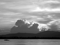 The Boat (Biswajit Dihidar) Tags: sunset blackandwhite water clouds river boat assam brahmaputra