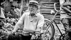 Fiddler (Subdive) Tags: park blackandwhite bw music man sweden folk västerås fiddler spelman nyckelharpa vallby outdoormuseum folkmusik canonef80200mmf28l canoneos60d vallbyopenairmuseum firluftsmuseum