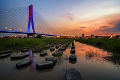 新北大橋 - New Taipei City Bridge - TAIWAN (urbaguilera) Tags: new city bridge sunset summer color water reflections river nikon rocks daniel taiwan tranquility cable calm tokina taipei 城市 日落 臺灣 aguilera 天空 stayed danshui 淡水河 漂亮 倒影 美麗 石頭 臺北 國家 光線 大橋 結構 d5000 1116mm 新北市 urbaguilera 建筑設計