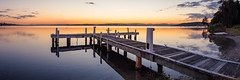 Day's End (Torkn2U) Tags: sunset panorama lake water still dusk belmont pano jetty australia calm wharf newsouthwales lakemacquarie squidsink