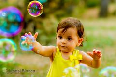 Chasing after bubbles (Natx33) Tags: portrait childhood yellow portraits canon children eos soap colorful child bubbles nios 7d bubble infancia burbuja pompa jabn