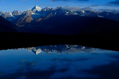 Reflections at Chandrataal (pranav_seth) Tags: morning blue lake mountains reflection clouds dawn himachal spiti himachalpradesh chandratal reflectiona blueandblack