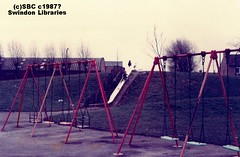 c1987: Playground at Gorse Hill, Swindon (Local Studies, Swindon Central Library) Tags: park colour playground children play 1987 swings swindon slide swing photograph sbc wiltshire 1980s gorsehill