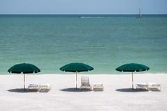 Beach Umbrellas and Chairs (F7sound) Tags: beach gulfofmexico water sand chairs florida umbrellas bonitasprings michaeloster 55210mm f7sound sonya6000