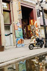 Scooter (JoelZimmer) Tags: travel canada reflection vertical winnipeg vespa manitoba highlighted oldmarketsquare streetartgraffiti nikond7000
