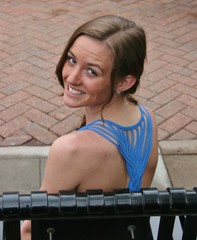 Over the Shoulder Smile (PhotoAmateur1) Tags: morning blue red portrait woman brown black brick beautiful beauty smile face smiling contrast bench hair neck fun outside outdoors nose photography photo necklace back am spring eyes dress photoshoot top gorgeous side profile over young picture down lips brunette shoulder throat upside whimsical
