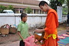 The monks do their bit of charity as well (shankar s.) Tags: southeastasia earlymorning buddhism tourists lp laos luangprabang buddhistmonk laopdr makingmerit unescoworldheritagecity buddhistreligion takbat buddhistfaith morningalmsgivingritualluangprabang morningalmsgivinginluangprabang