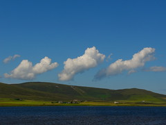 Clouds over Kirbister (stuartcroy) Tags: blue b light brown white lake beach water beautiful weather clouds butterfly landscape bay boat orkney day waves cloudy panasonic loch dmcfz10 orphir kirbister infinitexposure