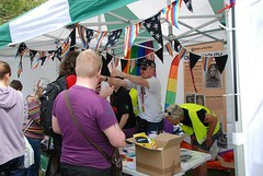 "Busy Pride Stall - Plymouth Pride 2014 • <a style=""font-size:0.8em;"" href=""https://www.flickr.com/photos/66700933@N06/14900444273/"" target=""_blank"">View on Flickr</a>"