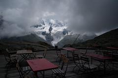 Please take a seat! @ Restaurant Fuorcla Surlej . 2755m (Toni_V) Tags: mist mountains alps fog clouds schweiz switzerland europe nebel suisse hiking 28mm rangefinder glacier alpen svizzera gletscher tisch stuhl engadin wanderung m9 2014 oberengadin graubünden grisons svizra berghaus grischun fuorclasurlej elmaritm ©toniv leicam9 140823 vadretdatschierva l1018062