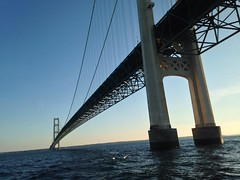 Passing Underneath The Mackinac Bridge (Explore) (rabidscottsman) Tags: scotthendersonphotography squareformat iphone iphone5c bridge greatlakes lakemichigan lakehuron friday travel mackinacbridge michigan steel towers cables interstate75 water dusk sunset mackinawcitymichigan usa unitedstatesofamerica underneath fav300 ios fav275 explore geotagged socialmedia flickr