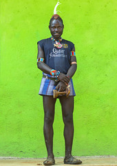 Hamer Tribe Man With A Barcelona Football Shirt, Key Afer, Omo Valley, Ethiopia (Eric Lafforgue) Tags: barcelona africa wood portrait people man men smile smiling vertical outdoors photography necklace football day adult african traditional picture feather jewelry skirt tribal pillow photograph bracelet blackpeople warrior omovalley tradition ethiopia tribe hairstyle cultures bizarre bana hamar oneperson onepeople frontview lifestyles hornofafrica fashionable ethiopian omo banna headrest greenbackground tribesman onepersononly qatarairways traditionalclothing realpeople footballshirt lookingatcamera onlymen fulllenght colorpicture onemanonly onematuremanonly keyafer indigenousculture africanculture keyafar snnpr southernethiopia truepeople colourpicture blackethnicity modernityandtradition sleeveshirt ethiopianethnicity greenbackgroung ethio1403458