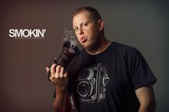 Smokin (JGo9) Tags: camera portrait man male guy canon smoke tshirt dude smokin dodgeburn