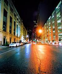 Walnut Street (torn8o) Tags: reflection kansascity wetpavement walnutstreet converginglines canonelan7 kodakektar pavementinrain