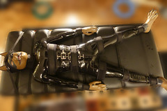 DSC02284 copy (Kory / Leo Nardo) Tags: pup pupplay rubberdawg rubber latex catsuit dawg mask suit gear corset hood paws bondage straps tied velcro massage table dog dobie doberman 2017 pupleo kory leo