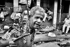 In the streets of Kolkata (paola ambrosecchia) Tags: india kolkata monochrome blackandwhite light man portrait street citylife face eyes bnw amazing people biancoenero life streetphotography