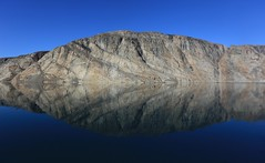 Mirrored Reflections Gibbs Fjord Baffin Island Canada Arctic (eriagn) Tags: travel sea summer canada expedition vertical reflections spectacular landscape waterfall ancient rocks day distorted patterns glacier arctic erosion clear granite inuit northamerica mirrored remote fjord zodiac geology coal habitat volcanic nunavut fiord sedimentary tranquil magnificent fossils stroch sheer stupendous mirroring otherworldly baffinisland weathering topography schist glaciation metamorphic canadianshield gneiss gibbsfjord akademikioffe oneocean naturesabstract eriagn ngairelawson ngairehart 70thanniversaryofthestroch scottinlet