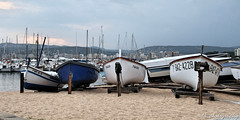 Boatmen (darusmois) Tags: ocean blue sea wallpaper sky panorama sun white water yellow clouds dark boat spain sand waves sailing view bright yacht pals number deck letter sail catalunya ochre continent yachting dbphotography meetspain