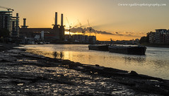 sunset over Battersea Power Station (vgallova) Tags: old uk light sunset chimney sky sun london abandoned industry station thames architecture river construction chelsea factory exterior power riverside cities structure electricity british battersea generation built supply