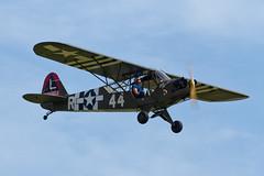 Piper L-4H Grasshopper - 3 (NickJ 1972) Tags: aviation airshow duxford grasshopper piper l4 2014 iwm flyinglegends r44 j3c gbmkc 329854 littlerockette