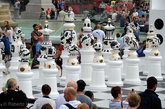 Giant chess pieces in Trafalgar Square, London, England. The Tournament, an installation created by Spanish designer, Jaime Hayón consists of a gigantic chess set, with 2m high ceramic pieces designed by Hayón on a specially created mosaic glass board. Th (Roberto Herrett) Tags: uk england people game london english horizontal set giant pieces board chess trafalgarsquare tournament installation british spectators popular 2009 stockphoto londondesignfestival jaimehayón rherrettflk chessfederation