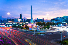 Victory Monument (p_lawliet) Tags: road city longexposure light red monument circle landscape thailand lowlight cityscape traffic bangkok thai lighttrails bluehour th bkk stacked lighttrail trafficcircle