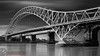 The Silver Jubilee Bridge (Adrian Court LRPS) Tags: longexposure bridge bw cloud water river runcorn widnes rivermersey runcornbridge silverjubileebridge leefilters openarchbridge