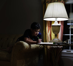 Homework (Vip Nigam) Tags: school light boy reflection english window lamp yellow kids night pen paper notebook photography lowlight low models assignment naturallight science grade iso fabric elementaryschool math drapes