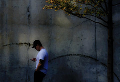 guy walking with cell (dotintime) Tags: light shadow guy hat walk cell tshirt cap meganlane dotintime