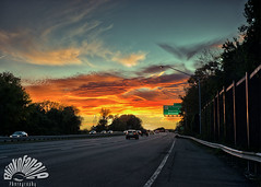 Friday sky (Blinkofanaye) Tags: road trip trees sunset orange usa sun car yellow clouds fence highway dramatic barrier
