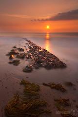 Layers of light (John Insipidus) Tags: uk longexposure sunset sea orange sun blur beach nature water landscape seaside rocks cornwall stones shore sunbeam insipid insipidmedia johninsipid