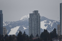 Spring Break skiers on Grouse Mountain (D70) Tags: spring break skiers grouse mountain chair lifts action note wind turbine right high rises metrotown burnaby bc canada sigma 150 600 mm f5 63 dg os hsm contemporary nikon d750 150600mm f563 tc1401 teleconverter silk monopod