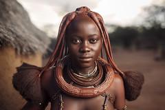 Himba Woman (Sean Tucker Photo) Tags: himba thehimba namibia tribal dreads dreadlocks africa african africanwoman africantribe jewe jewellery canon5dmkii sigma50mmart sigma50mmf14 strobist onelight beautifulwoman rembrandtlighting travel travelphotography redtones earthy seantuckerphotography seantucker hut redclay tribes world paulcbuff alien b 800 alienb800 alienbee800